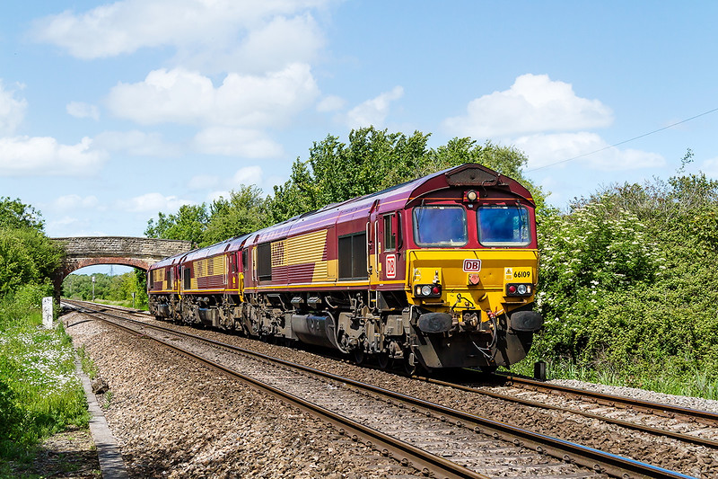 6th Jun 2015;  0X12 the Saturday Convoy from Margam to Westbury loaded to only 3 today.  66109, with DB branding, 66138 & 66020 are captured as they near Hawkeridge Junction at the end of thier journey.