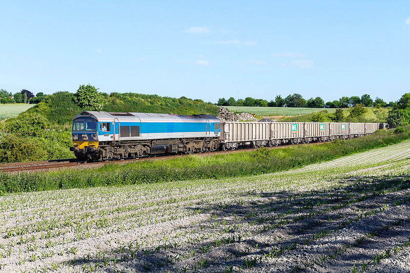 10th Jun 2015:  Approaching Old Dilton on the drop down from Upton Scudamore is 59004 in charge of 6V12 from Woking to Merehead