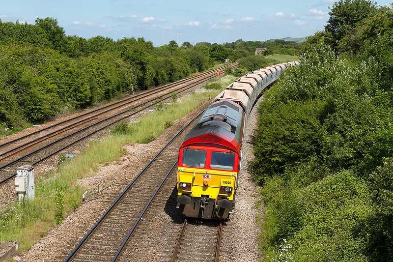 16th Jun 2015:  Rounding the final curve on the Westbury New Line at Fairwood Junction is 59205 in charge of 7C77 from Acton to Merehead.  Not the shot that I had planned as I had  expected it to be on the normal route through the station.  Still for me it works quite well.