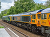 9th Jun 2015:  Probably my worst ever attempt at a picture. 59003 'Yeoman Highlande'' on tow in 0O59 from the WSR to Eastleigh.  Behiind are 56006 & 45060