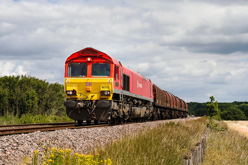 23rd Jun 2015:  The first shed to be painted into Schenker livery 66152 is captured nearing the Hullavington Loops with 6B50 from the Swindon Steel terminal to Llanwern empties