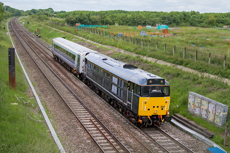 23rd Jun 2015:  Devon & Corwall Railways Class 31  31601  brings a newly refurbished  Chiltern Railways Mk 3 coach from Bristol Barton Hill to Wembley.  The OLE mast base planting sessions seem  to be only about 50% successful in this area