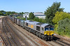 30th Jun 2015:  About to cross the Mount Pleasant level crossing   the Ex Dutch shed now GBRf 66748 brings 6Y19 empty Gypsum containers from Mountfield to Souhampton Western Docks past the River Itchen