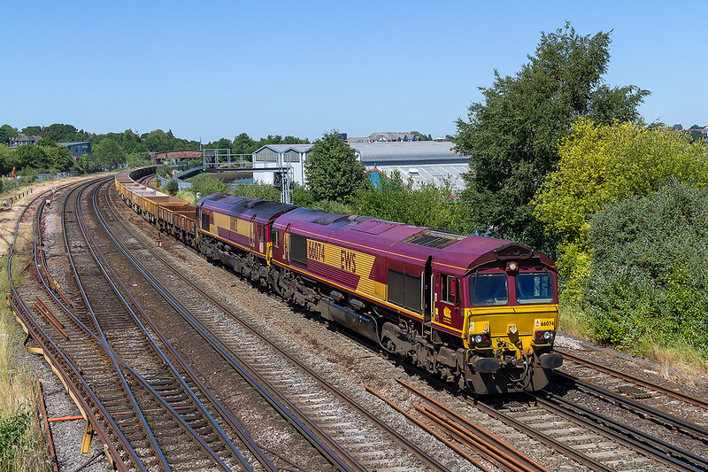 30th Jun 2015:  The afternoon return engineers service from Eastleigh to Westbury is powered by 66074 with 66182 DIT is pictured fron the foot bridge at Moount Pleasant Crossing