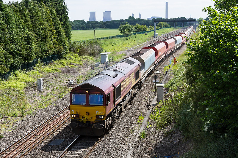18th Jun 2015:  Leaving the loop at Steventoon is 66009 at the helm of 6Z47 from Wembley Eurofreight Centre to Cardiff Docks Ryans.  The wagons are all the same but some have yet to be repainted into the DB Schenker livery