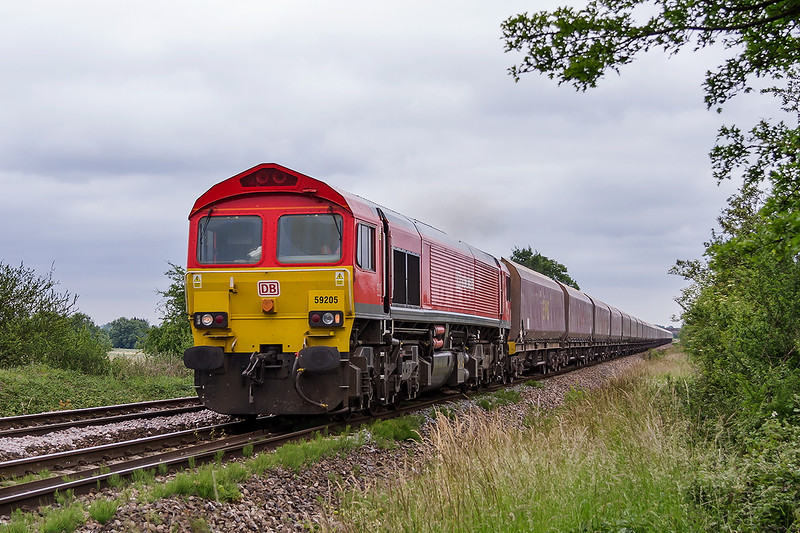 26th Jun 2015:  With the EWS coal tubs on the hook 66205 accellerates away from Fairwood Junction with 7C31 from Theale to Merehead.  Quite a few of the waggons have had the EWS on the side over painted in maroon.