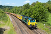 7th Jun 2015:  Running an hour and thirty six minuutes late 70011 with 6Y20 from Llandore Junction to Westbury races through Freshford