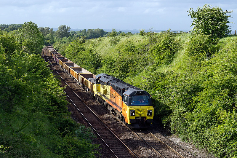 2nd Jun 2015:  Colas 70804 dodges the shadows as it climbs thw last few yards to Upton Scudamore with 6O31 departmental from Westbury to Eastleigh