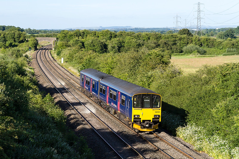 29th Jun 2015:  150102 is working as 5Z59 ECS from Bristol Temple Meads to Castle Cary where it will pick up another load Glastonbury followers.  The Berkley Marsh bridge is in the background