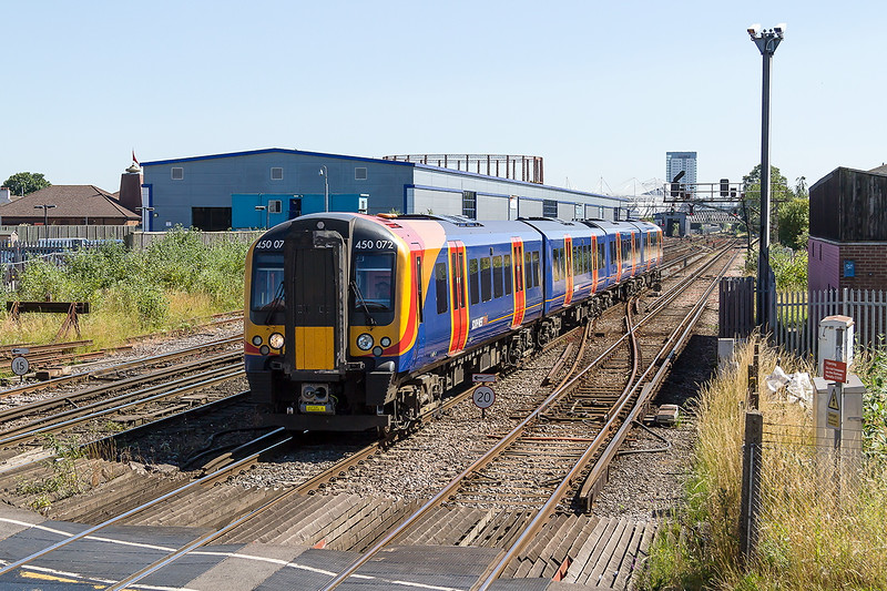 30th Jun 2015:  450072 is working 1W18 the 12.18 from Weymouth to Waterloo.  At least the  450 is clean which is more than can be said fora ll  the 444s that passed.  Mount Pleasant Crossing