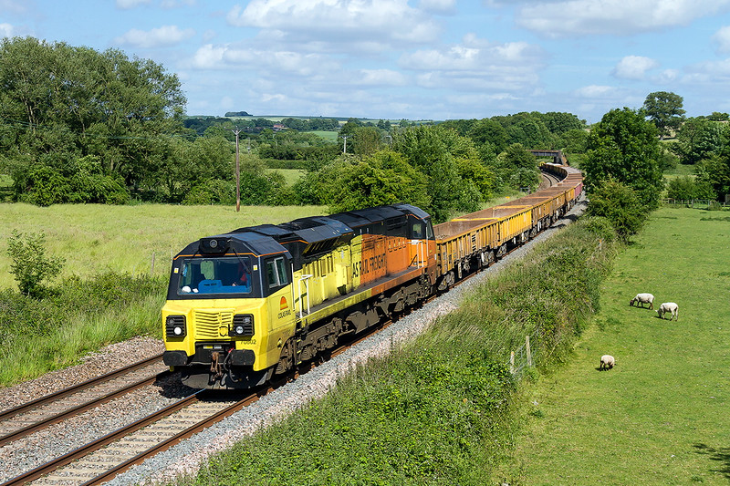 21st Jun 2015:  Having worked to Slough yestarday 70802 returns to Westbury as 6C35 and makes a fine sight as it passes through Great Cheverell