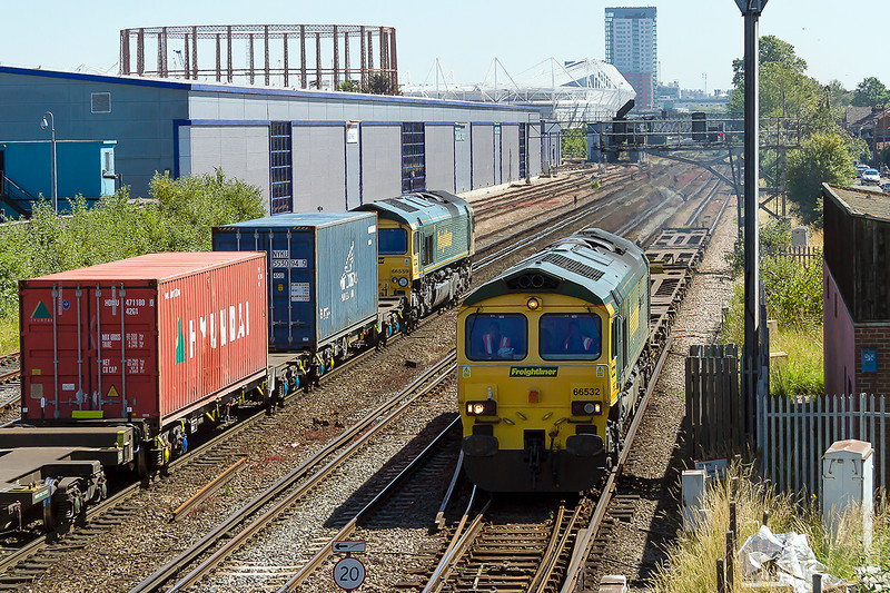 30th Jun 2015:  At Mount Pleasant Crossisng 66532 has 4 container flats on 4B90 from Southampton Maritime to Eastleigh as 66559 heads south with 4O27 from Garston