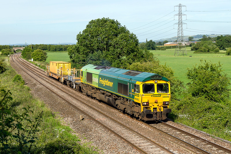 16th Jun 2015: The Hinksey to Fairwater Yard ran today hauled by the Shanks machine 66522.  Of course the green end was leading and the load was one HOBC container.  Pictured at Berkely Marsh near Frome.  One day I shall amanage to get it Lime end leading, perhaps.