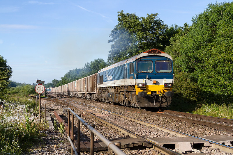 25th Jun 2015:  On a beautiful evening 59102 in charge of 7C64 from Acton to Merehead is pictured as it passes Blatchbridge Junction in Frome