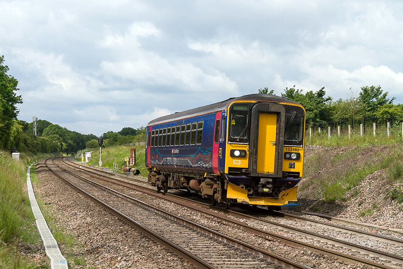 23rd Jun 2015: 2M06 the 09.48 from Westbury to Swindon in the hands of 153382 catches some sunlight at Hay Lane near Junction 16 on the M4