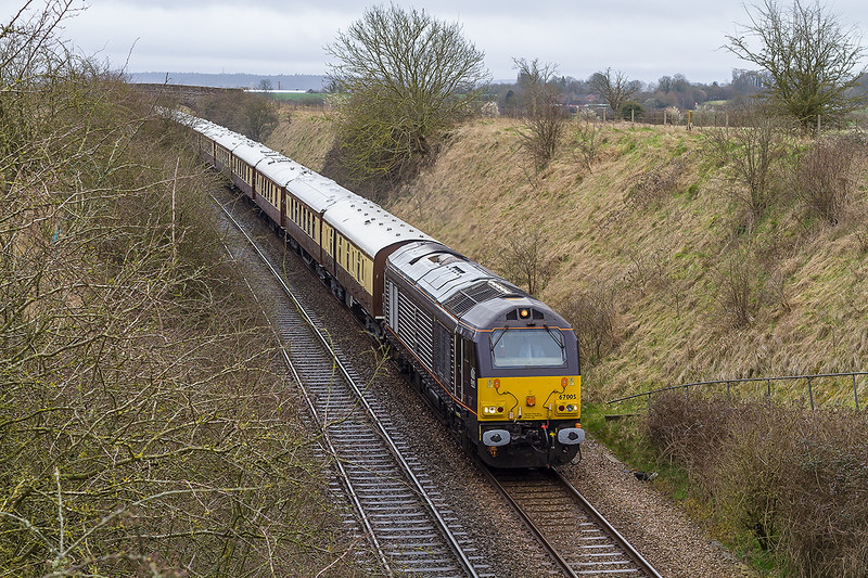 28th Mar 2015:  Bropping down the bank at Upton Scudamore is 67005 on the front of the Belmond Orient Express from Victoria to Bath and Bristol.  67028 was on the other end.