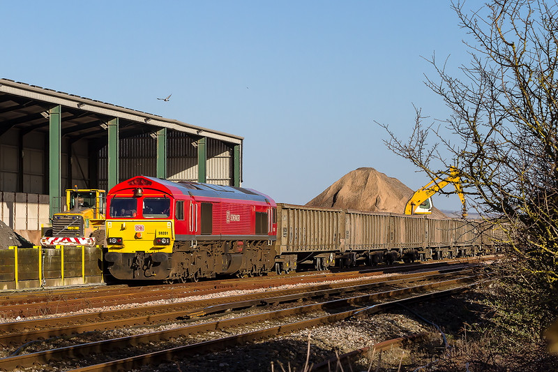 4th Mar 2015:  59201 being loaded in  Newhaven Day's Siding with ash from the recycling plant,  At  12.15 it will head back to Acton as 6V00 .