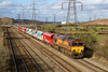 26th Mar 2015: The lovely rake of Schenker red repainted NP hoppers are now getting split up and grafittied.  66099 heading west at Duffryn with 6Z47 from Wembley Eurofreight terminal to Cardiff Dock Ryans FW in nice afternoon light