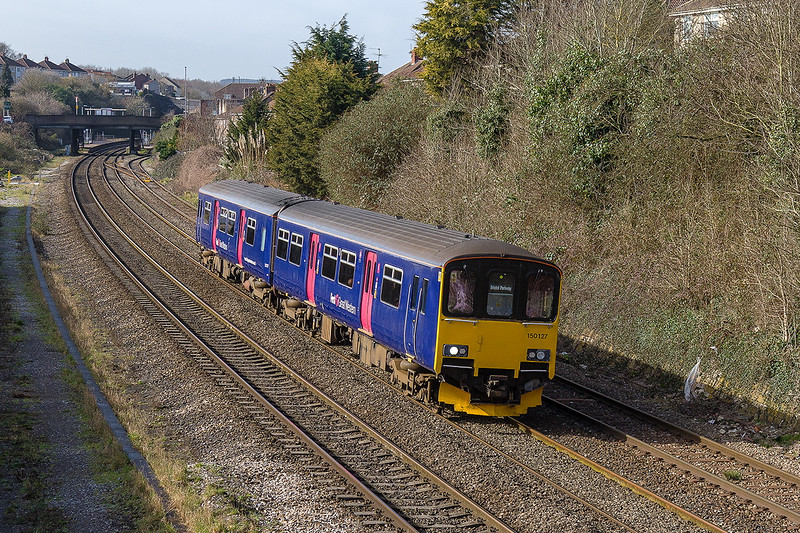 10th Mar 2015:  The 10.48 from Taunton to Bristol Parkway, 2D08, is running 10 minutes late as it leaves Parson Street staion.  150127 had a problem and when it arrived at Temple meads the rest of the journey to Parkway was cancelled