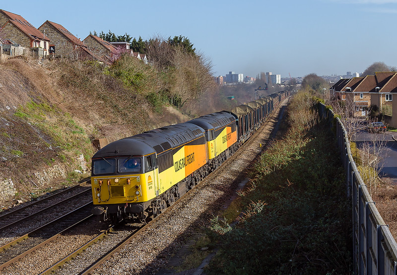 10th Mar2015:   Running about an hour early past the site of Malago Vale Carriage Sidings iis 6V54 the empty log carriers from Chirk to Teigngrace.  Going well and making a nice nice roar are Colas Grids 56105 & 56078