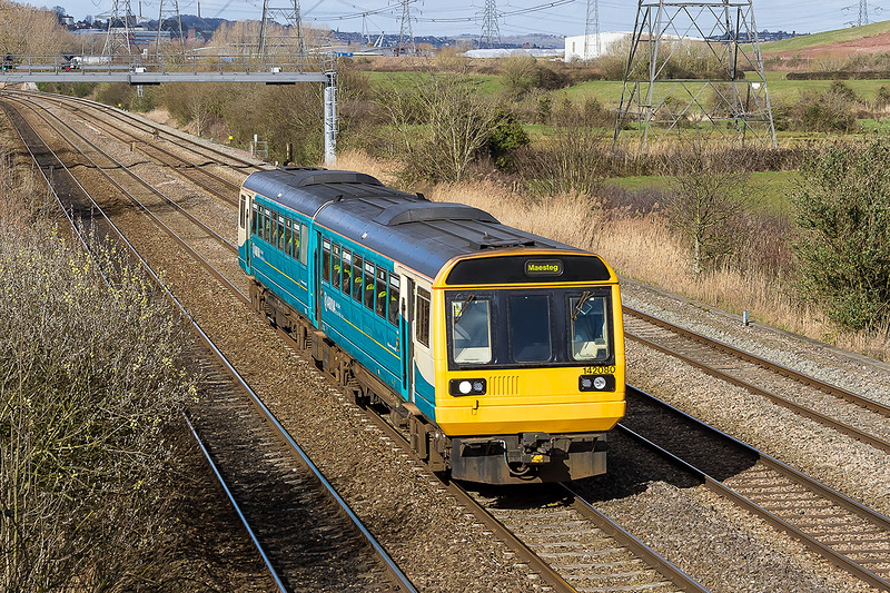 26th Mar 2015:  How much longer have these 4 wheel bouncy coach sets  be in use?  They are all suposed to be gone by 2020.   Arriva Trains 142080 is heading to Maesteg with 2L59 the 13.45 from Cheltenham Spa