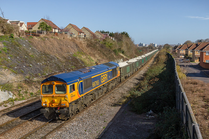 10th Mar 2015:  66765 in in charge of 6V80 loaded with Gypsum today starting from Hexthorpe is going to Portbury Coal Terminal.  Pictured from the foot bridge on Shepton Walk in Bristol