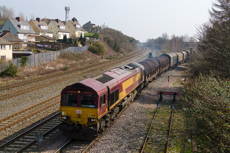 18th Mar 2015:  Schenker branded 66137  pushes steel carries fron East Usk Yard onto the Birdport branch