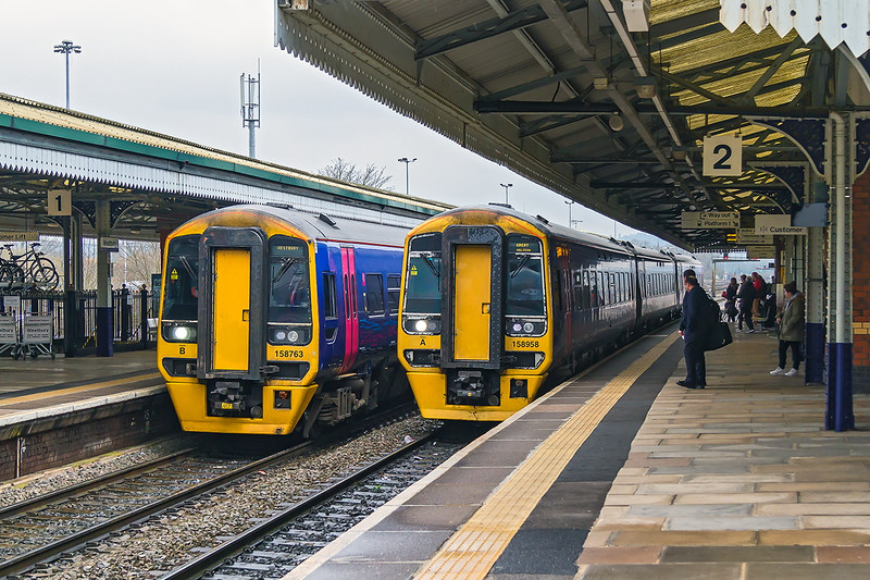 16th Mar 2015:  158763 is waiting to reverse from Platform 1  having recently arrived as 2F97 the 08.50 from Great Malvern and 158958 is working 1V94 to Great Malvern.  Usually from Brighton but today only from Worthing.