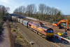 10th Mar 2015:  66035 is working 6O32 from Margam to Dollands Moor though Wapley.  The picture is taken from a temporary foot bridge beimg used white the occupation bridge is being reconstructed..  This point was once the start of 'Wapley Sidings' which gave acces to the enormours Army stores depot (called Wapley Common) on what is now a  large housing estate .