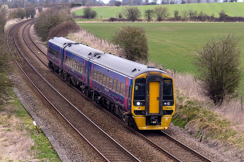 8th Mar 2015:  I went to Granade Bridge on the Warminster By-pass to picture the 2 returning Grids but I ballsed up the shot!!   Taken as a test shot is 158952 working 1F09 the 10.20 Swindon to Portsmouth Harbour.