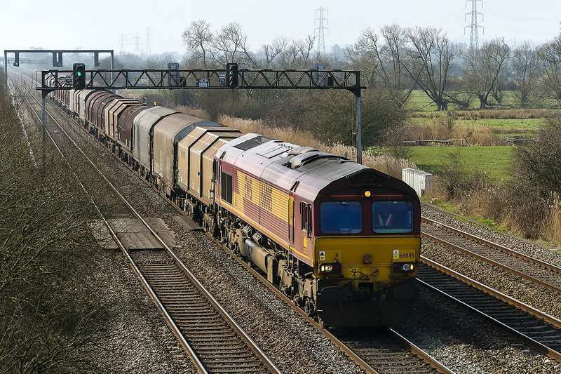 18th Mar 2015:  At 12.14 66085 with a good rake of steel carries runs East at Coedkernew.  I cannot work out what the service is unfortunately