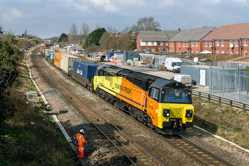 25th Mar 2015:  Hired in by Freight Liner Colas 70803 hurries through Wootton Bassett with 4O51 from Wentloog to Southampton.  A bfew seconds later and cloud covered the sun