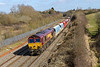 10th Mar 2015:  66182 with DB Schenker stickers runs past the site of Wapley Sidings while  working a colourful rake of hoppers from Wembley Eurofreight Terminal to Cardiff Dock Ryans FW