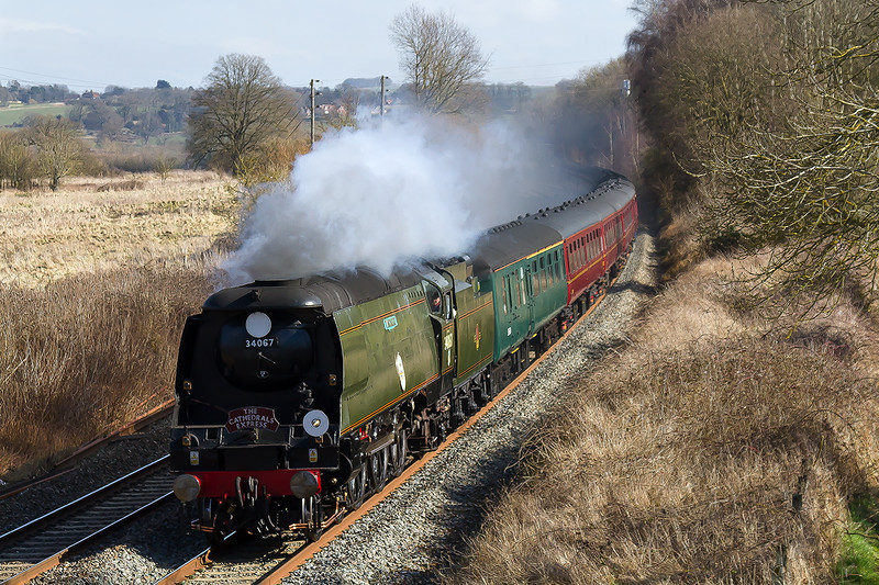 7th Mar 2015:  Battle of Britain class 4-6-2  34067 'Tangmere' racing down the grade through Lavington with the 2nd half of the outward leg of the days Cathex from Southend to Bristol.  The first part, as far  as Southall,  was in the hands of 61306