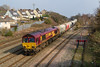 18th Mar 2015:  Running under the normal WTT code of 6B35 through East Usk Junction  is 66040 with EWS empty hoppers from Hayes and Harlington Tarmac Sidings to Moreton on Lugg