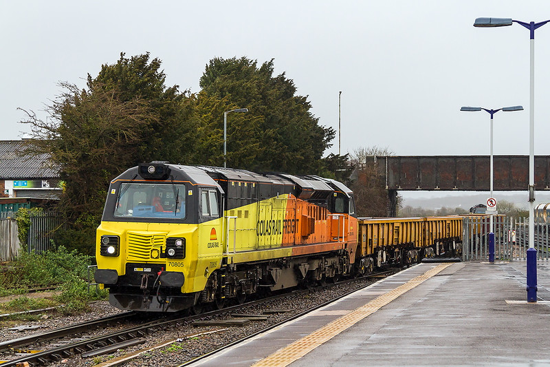 29th Mar 2015:  On a very wet and windy Sunday morning 70805 working 6C23 brings the JNA/MLAs and sleeper wagins back from Cardiff West to Westbury Up Yard.  Just visible at the rear is Class mate 70802 which took the loaded wagons to Cardiff on Saturday