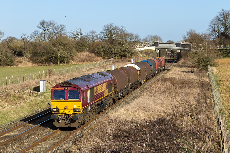 10th Mar 2015:  Running nice and early through Acton Turville  are the empties from the Swindon Steel Terminal to Llanwern.  6B50 is in the hands of 66116