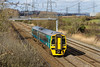 26th Mar 2015:  Pottering along the fast through Duffrtn at15.20  is Arriva Trains Wales 158840. Regrettably I have no idea what the service was .