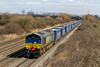 26th Mar 2015:  A rather grubby 66422 powers 4V38 Tesco Express from Daventry to Wentloog through Coedkernew