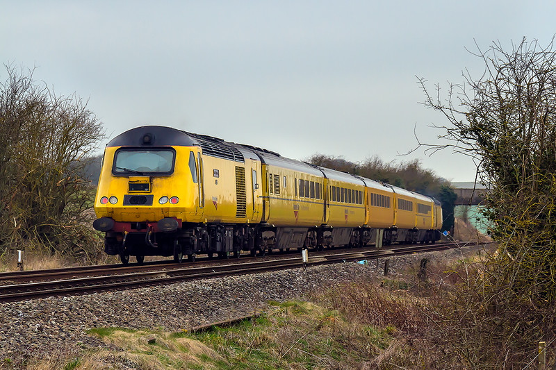 12th Mar 2015:  The final section of 1Q23's work was from Salisbury to Old Oak Common,  this included a quick jaunt to Westbury and back.  Captured passing through Bapton with 43013 leading and 43014 'The Railway Observer' at the rear, unfortunately the early morning brightness was long departed.