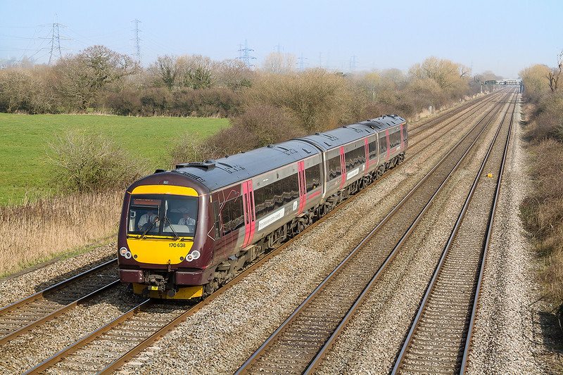 18th Mar 2015:  1V06 is the 09.10 Cross Country service from Nottingham to Cardiff.  Today trusted to 170638 it is picturd at Coedkernew a few miles west of Newport