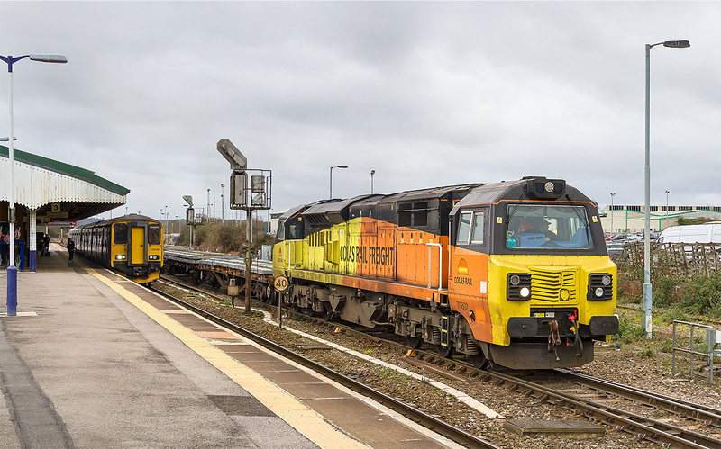 28th Mar 2015:  Leaving 10 minutes early is Colas 70802 (it has never had a number on this end) working 6C23 to Cardiff.  After the new sleepers there was a rake of JNA & MLAs.  150248 sits in Platform 3 with the 08.46 from Weymouth to Gloucester