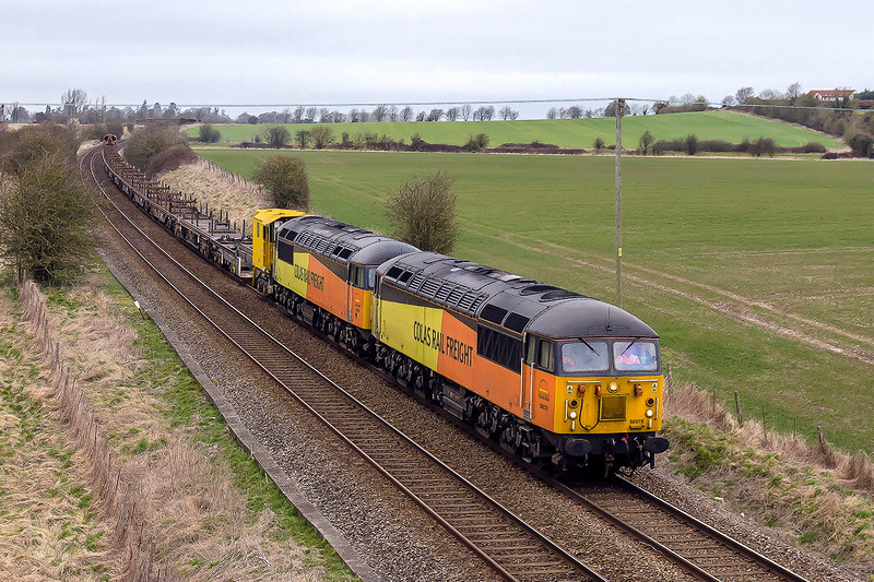 8th Mar 2015:    The Colas pair 56078 & 56105 are returning to Eastleigh from Fenny Compton with the now unloaded YEA wagons.  Bit of a crap shot really