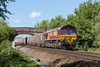 12th May 2015:  On a beautiful afternoon 66076 brings 6C48 the Appleford to Westbury empty boxes under the Dursley Road bridge in Heywood