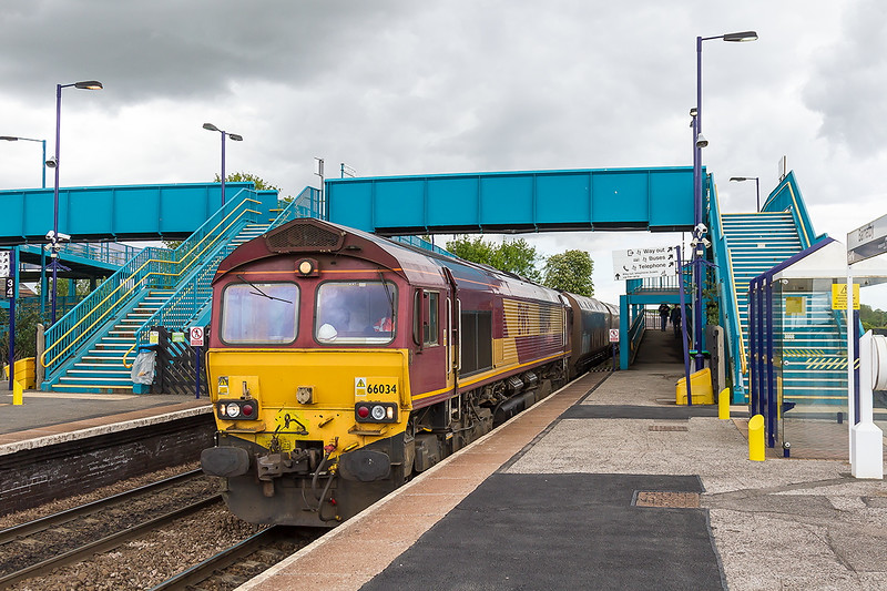 20th May 2015:  The foot bridge at Barnetby is much used by rail enthusiasts sometimes used by passengers.  66023 heads 6C76 the 13.00 Immingham Scunthorpe