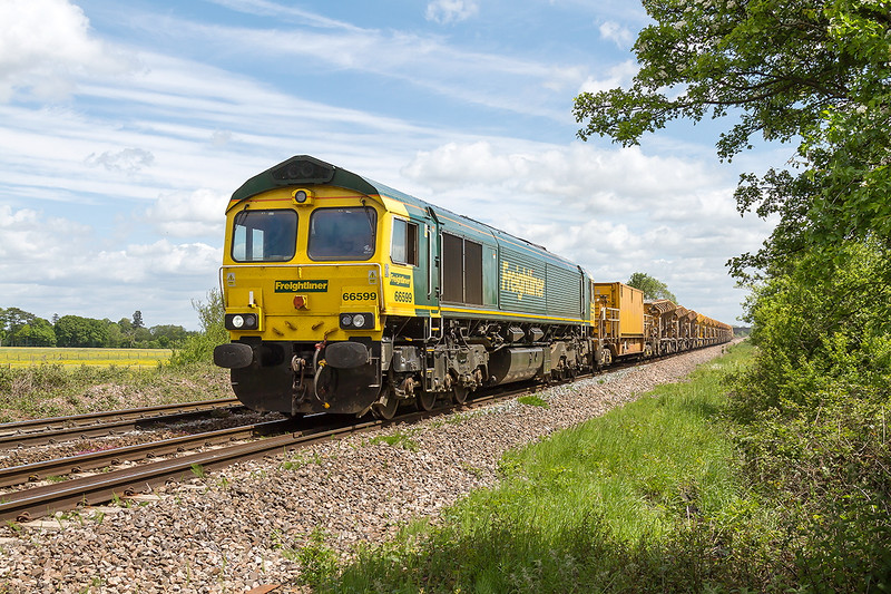 28th May 2015:  Now refilled the HOBC powered by 66599 crossesMasters Crossing on it's way back to Fairwater Yared in Taunton