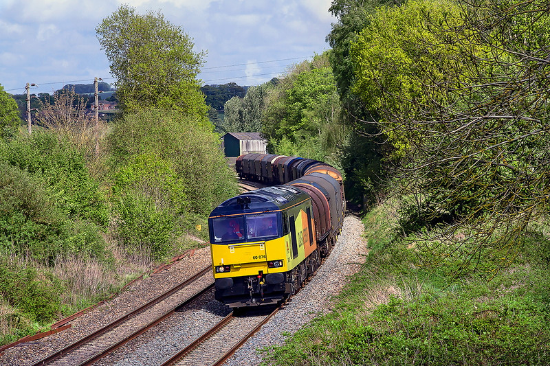 9th May 2015:  Running down the B & H through Lavington is Colas Rail Tug 60076 heading 6B33 from Theale to Margam.  My intended shot was to be much closer but by then the train was in total shadow.  A get out of jail shot.
