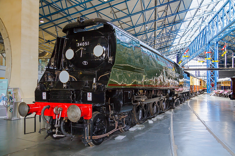 16th May 2015:  Following it's complete repaint at the Mid Hants Railway 34051 'Winston Churchill'  greets visitors as they enyer the Main Hall of the National Railway Museum.  Behind is the Southern Railway vehicle that was used to carry his coffin from Waterloo to Charlbury