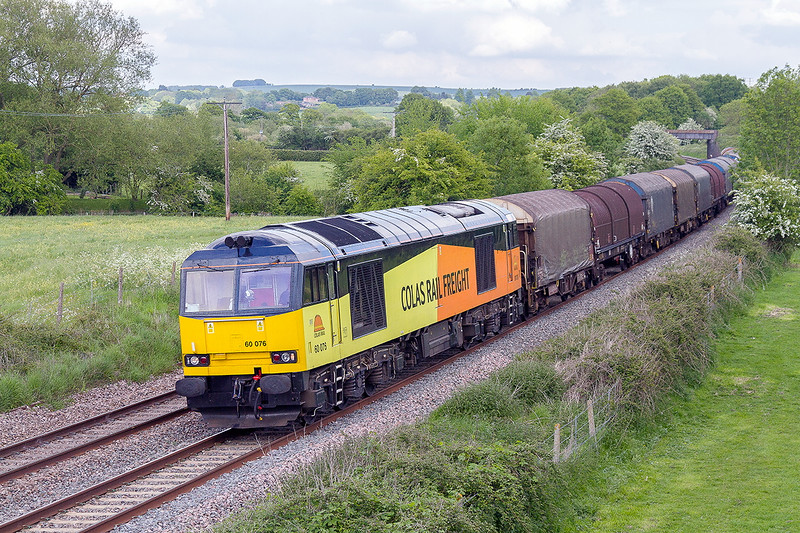 23rd May 2015:  Diverted again down the Berks & Hants is 6V62 covered steel empties from Tilbury to Llanwern.  Pictured at Great Cheverell with 60076 at the helm.