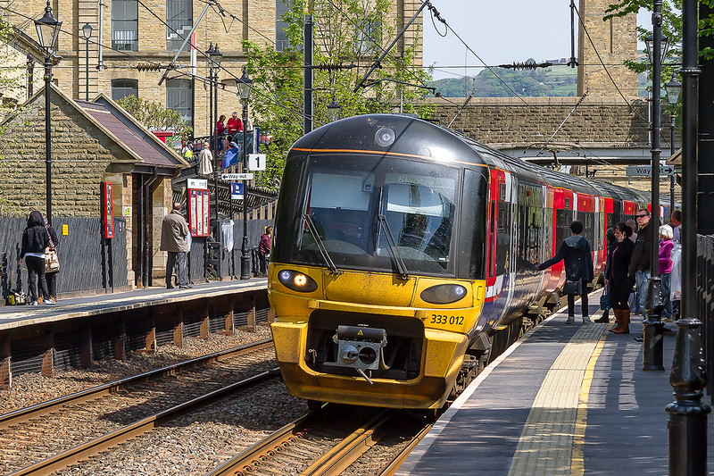 15th May 2015:  333012 comes to a stand at Saltaire when working 2S34 the 14.41 Bradford Forster Square to Skipton.